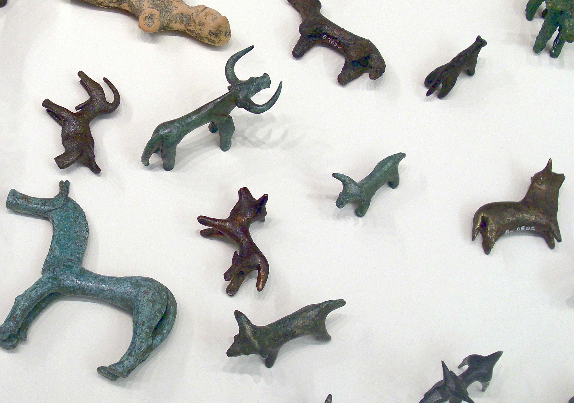 Bronze animal statuettes from Olympia. Votive gifts, 8th - 7th century BC. On display in the archeologic museum of Olympia, Greece. : Wiki Commons