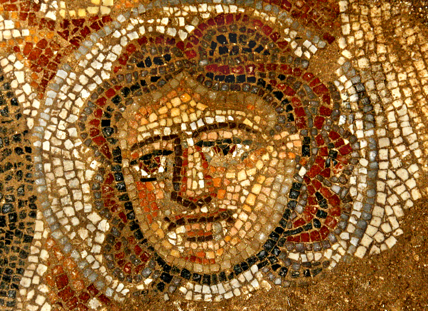 Mosaic depiction of a female face in the Huqoq synagogue