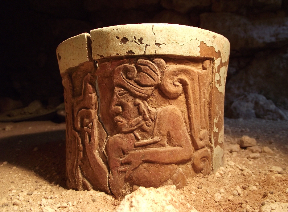 One of the relief-decorated ceramic vessels that served as a cocoa mug depicting a young man