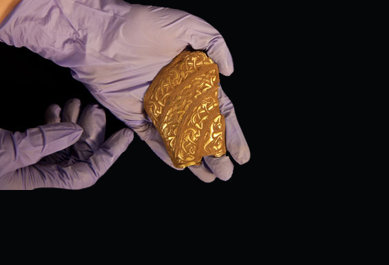Staffordshire hoard: part of a helmet was among the pieces unearthed in the Hammerwich field last month. Photograph: Staffordshire county council
