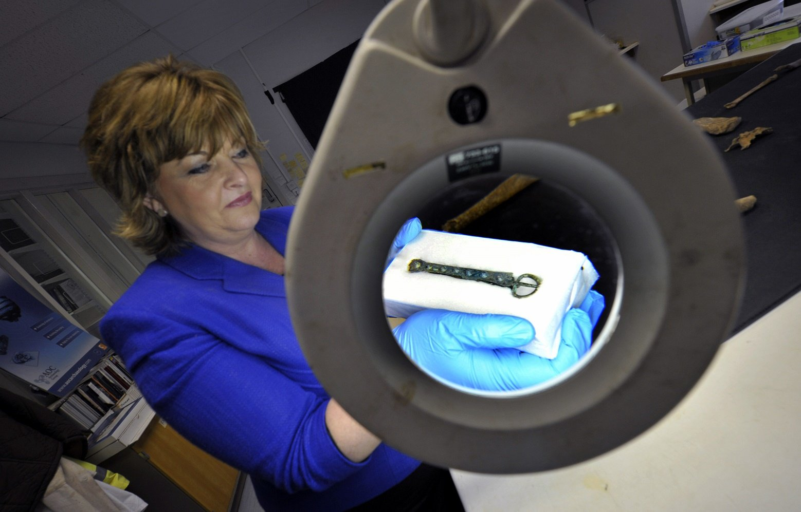 Fiona Hyslop (Cabinet Secretary for Culture and External Affairs) viewing a tenth-century belt buckle which was discovered on an archaeological dig at Auldhame (East Lothian). The belt was found with a skeleton which may be that of Olaf Guthfrithsson. Credit : Historic Scotland