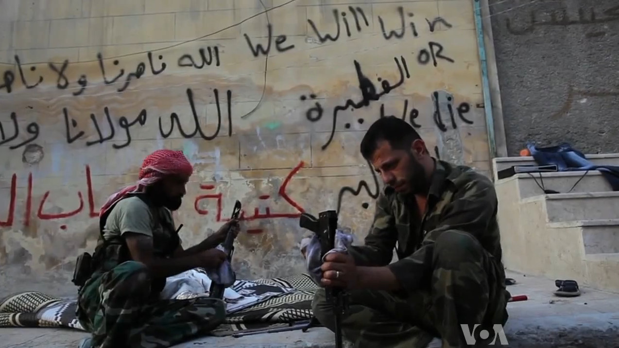 FSA_rebels_cleaning_their_AK47s