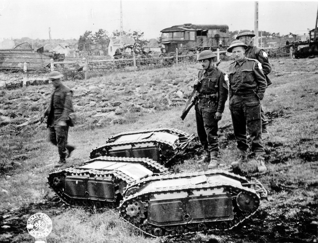 British soldiers with captured German Goliath tracked mines. Image Credit : WikiPedia