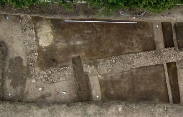 This is an aerial Image of the foundation of a Roman stone building. Length of the leveling staff (White) at the upper edge of the Picture: 5 meters. CREDIT : Dennis Braks