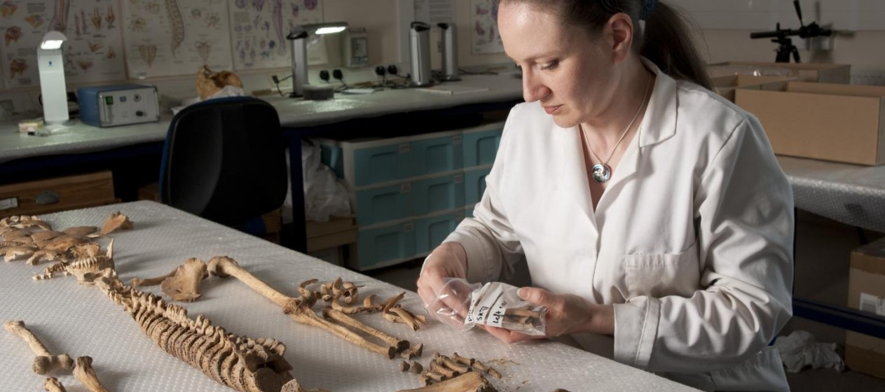 Dr Anwen Caffell lays out the remains. CREDIT : Durham University / North News