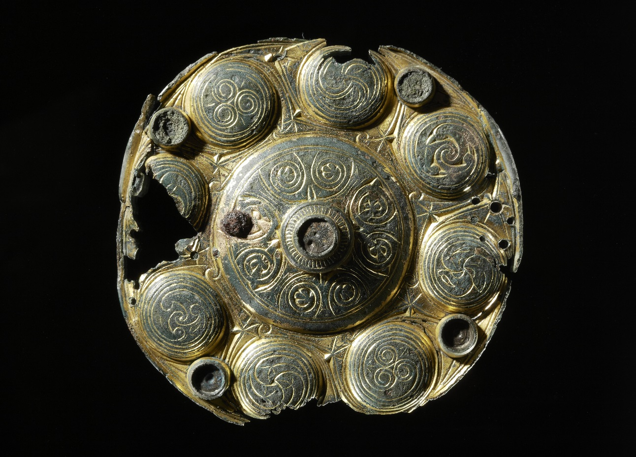 """Mounting from a reliquary, produced in Northumbria in the 8th century. The mounting have been modified and was used as a brooch. It was found in a woman's grave from the second part of the 9th century, in Buskerud, Norway "". Credit : Museum of Cultural History"
