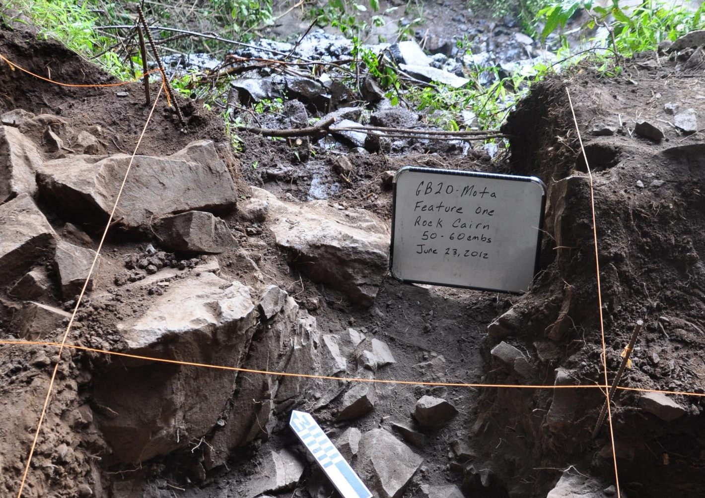 Mota cave -- this image shows an excavation of the rock cairn under which the burial was found. [Credit: Kathryn and John Arthur]