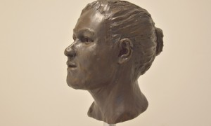 This is a reconstruction of the Ballynahatty Neolithic skull by Elizabeth Black. Her genes tell us she had black hair and brown eyes. CREDIT Barrie Hartwell.