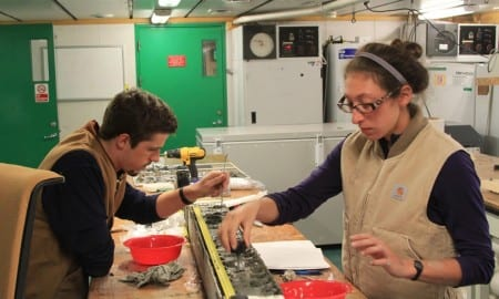 Rice University students Brian Demet (left) and Ruthie Halberstadt study a seafloor sediment sample aboard the NSF research vessel Nathaniel B. Palmer in the Ross Sea in 2015. CREDIT L. Simkins/Rice University