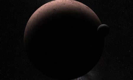 This artist's concept shows the distant dwarf planet Makemake and its newly discovered moon. Makemake and its moon, nicknamed MK 2, are more than 50 times farther away than Earth is from the sun. CREDIT Credit: NASA, ESA, and A. Parker (Southwest Research Institute)