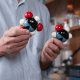 Nearly twins and possibly keys to a unlocking the mystery of the evolution of life-coding molecules. Nicholas Hud holds up Uracil, on the right, a nucleobase of RNA. Barbituric acid, on the left, looks very much like it and could have been part of a proto-RNA that preceded RNA. CREDIT Fitrah Hamid, Georgia Tech