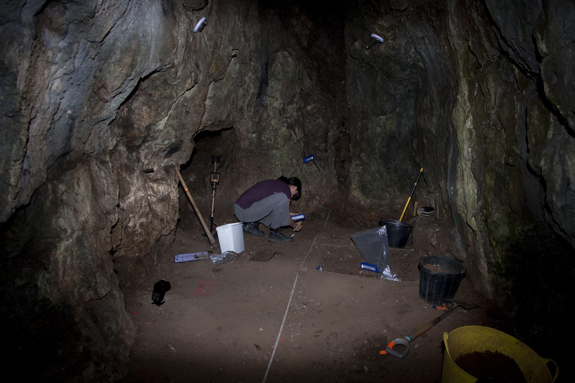 Excavating at back of Reynards Kitchen Cave © National Trust : D Slade