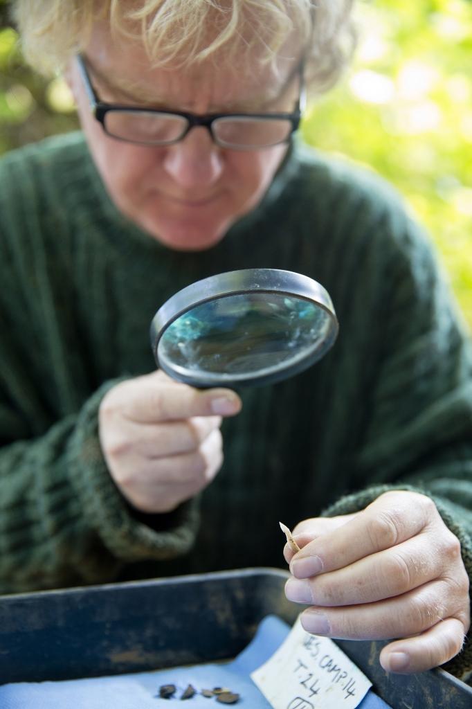 David Jacques magnifying glass - Image Credit : University of Buckingham