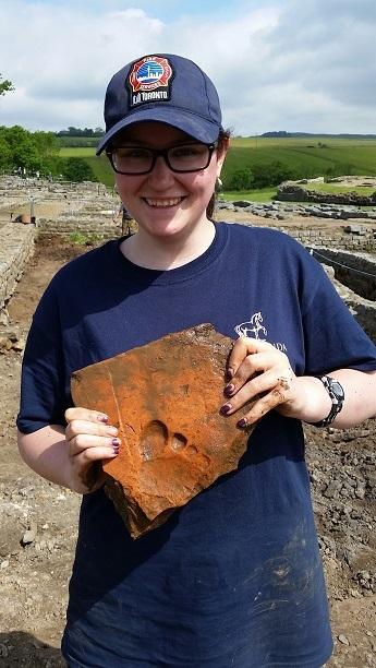Mel Benard with tile - Vindolanda Trust