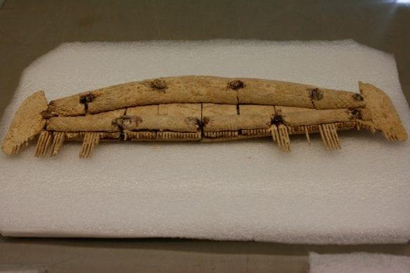 A bone comb found in a grave. [Crown Copyright/MOD2016]