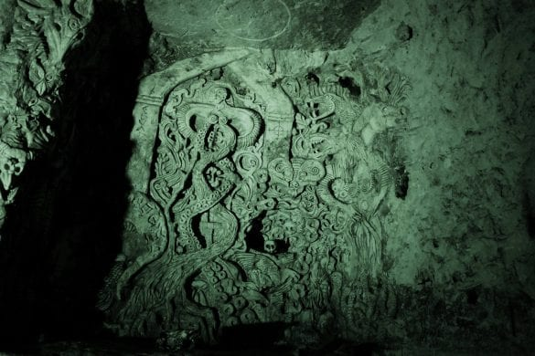 Carving done by the artist Sandy Brown in 1995 within the caves. - Credit : Markus Milligan