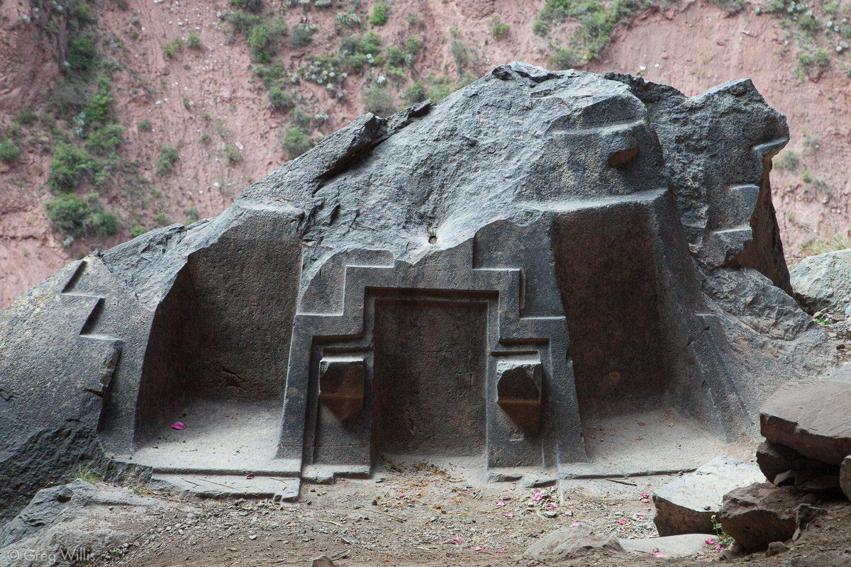 carved boulder with chakana motifs naupa iglesia